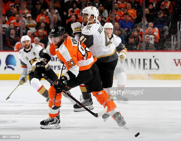Jakub Voracek of the Philadelphia Flyers and PierreEdouard Bellemare of the Vegas Golden Knights collide in the third period on March 12 2018 at...
