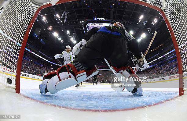 Jakub Voracek of the Philadelphia Flyers and Team Toews scores against goaltender Carey Price of the Montreal Canadiens and Team Foligno in the first...