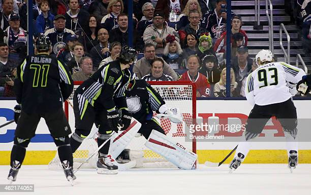 Jakub Voracek of the Philadelphia Flyers and Team Toews shoots against Carey Price of the Montreal Canadiens and Team Foligno in the first period...