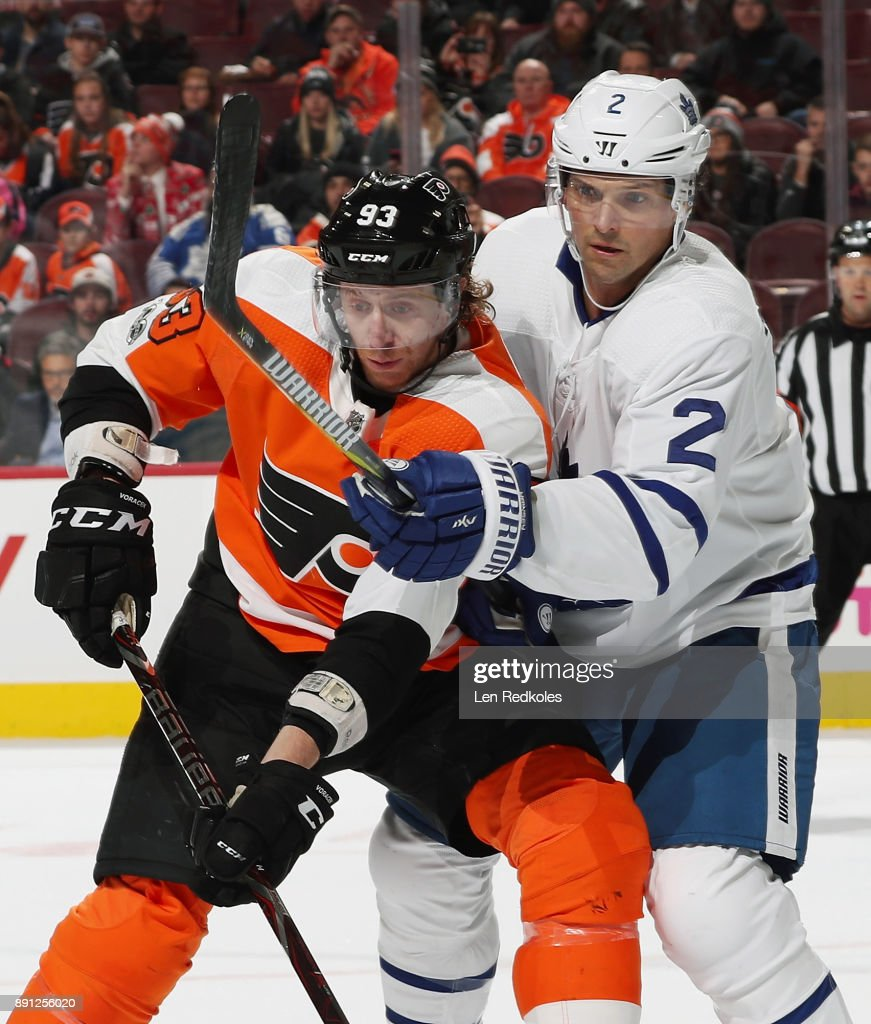 Jakub Voracek #93 of the Philadelphia Flyers battles for position with Ron Hainsey #2 of the Toronto Maple Leafs on December 12, 2017 at the Wells Fargo Center in Philadelphia, Pennsylvania. The Flyers went on to defeat the Maple Leafs 4-2.