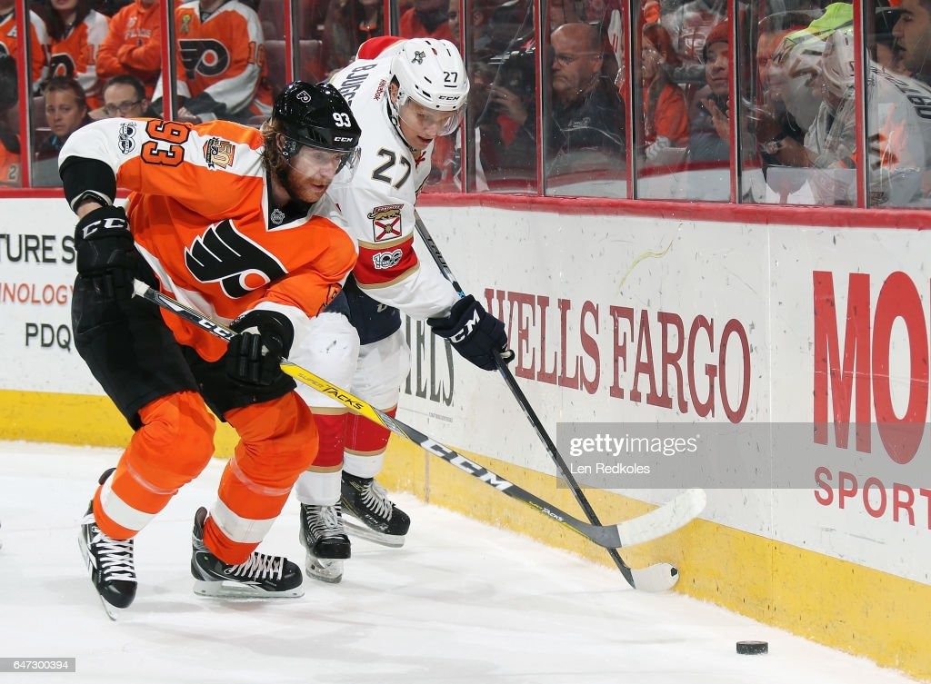 Jakub Voracek #93 of the Philadelphia Flyers battles for the loose puck along the boards with Nick Bjugstad #27 of the Florida Panthers on March 2, 2017 at the Wells Fargo Center in Philadelphia, Pennsylvania. The Flyers went on to defeat the Panthers 2-1 in a shootout.