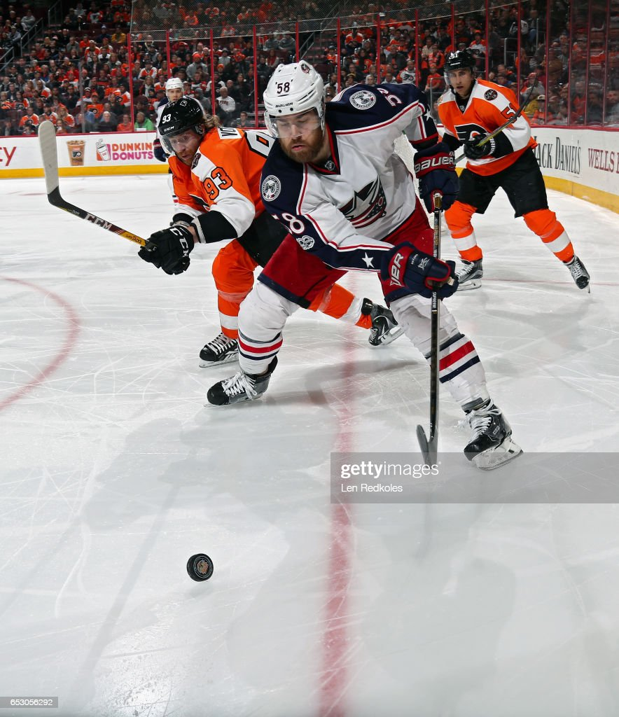 Jakub Voracek #93 of the Philadelphia Flyers battles for the loose puck in the corner with David Savard #58 of the Columbus Blue Jackets on March 13, 2017 at the Wells Fargo Center in Philadelphia, Pennsylvania. The Blue Jackets went on to defeat the Flyers 5-3.