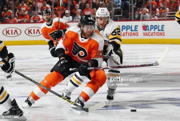 Jakub Voracek of the Philadelphia Flyers battles for the loose puck with Carl Hagelin of the Pittsburgh Penguins in Game Three of the Eastern...
