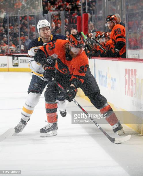 Jakub Voracek of the Philadelphia Flyers battles for the puck along the boards with Brandon Montour of the Buffalo Sabres on February 26 2019 at the...