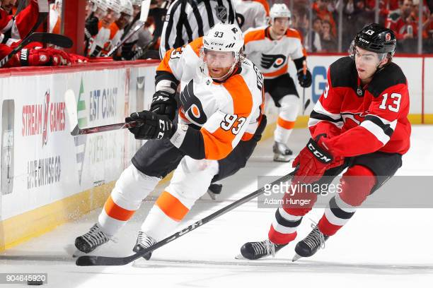 Jakub Voracek of the Philadelphia Flyers battles for the puck with Nico Hischier of the New Jersey Devils during the third period at the Prudential...