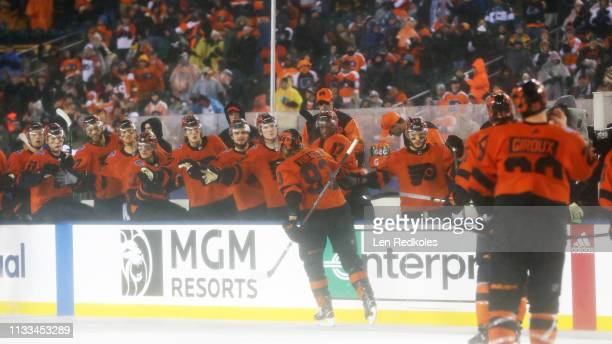 Jakub Voracek of the Philadelphia Flyers celebrates a third period goal with teammates on the bench against the Pittsburgh Penguins at the 2019 Coors...