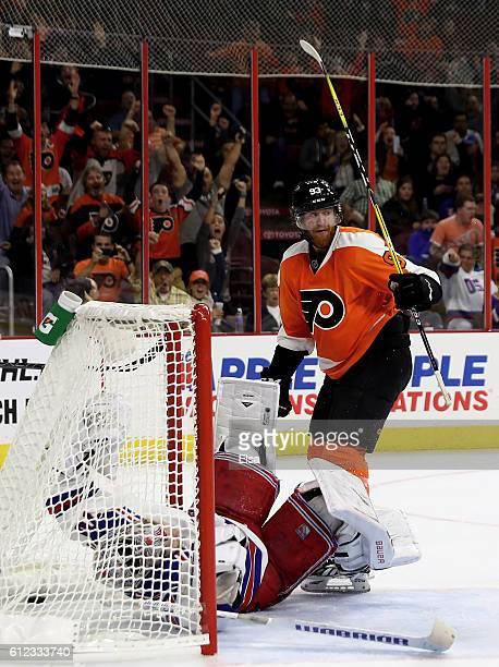 Jakub Voracek of the Philadelphia Flyers celebrates his game winning goal as Mackenzie Skapski of the New York Rangers defends during a preseason...