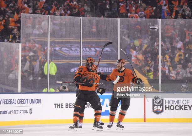 Jakub Voracek of the Philadelphia Flyers celebrates his gametying goal with teammates Shayne Gostisbehere and Sean Couturier in the third period...