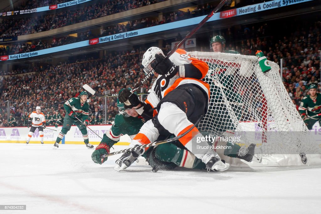 Jakub Voracek #93 of the Philadelphia Flyers collides with Mike Reilly #4 of the Minnesota Wild during the game at the Xcel Energy Center on November 14, 2017 in St. Paul, Minnesota.