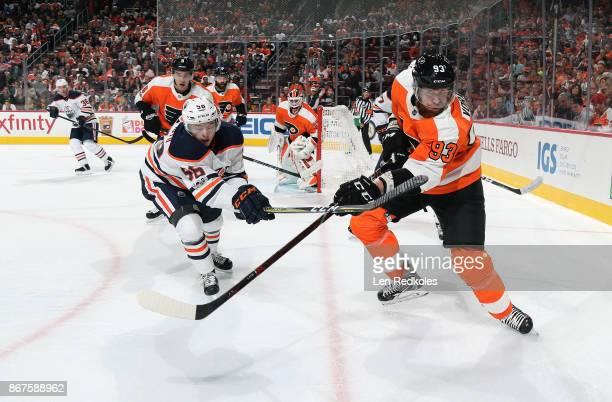 Jakub Voracek of the Philadelphia Flyers completes a pass against Kailer Yamamoto of the Edmonton Oilers on October 21 2017 at the Wells Fargo Center...