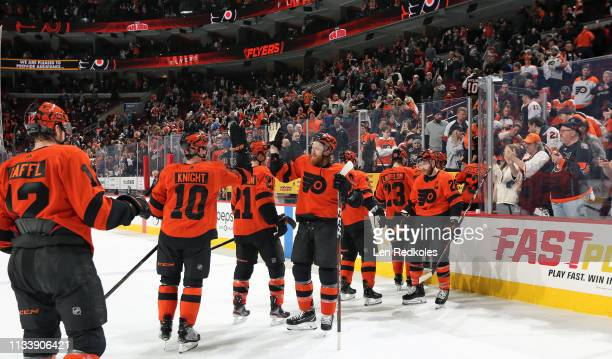 Jakub Voracek of the Philadelphia Flyers congratulates Corban Knight with teammates after defeating the Buffalo Sabres 52 on February 26 2019 at the...