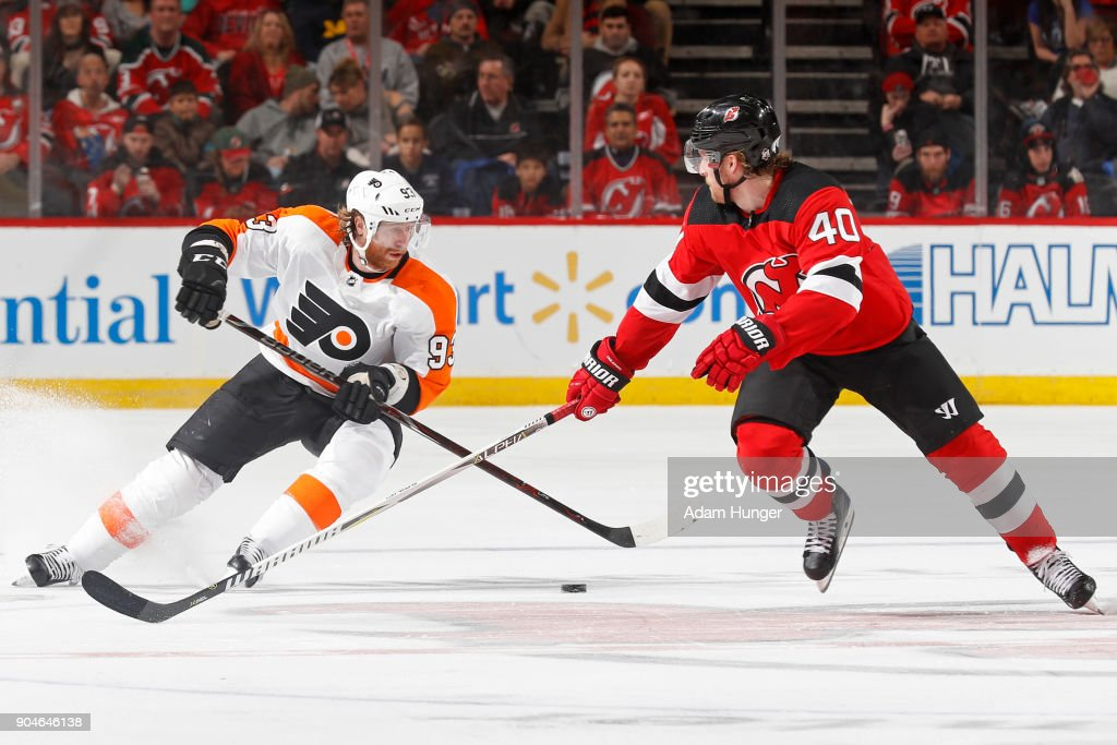 Jakub Voracek #93 of the Philadelphia Flyers controls the puck in front of Blake Coleman #40 of the New Jersey Devils during the third period at the Prudential Center on January 13, 2018 in Newark, New Jersey. The Flyers won 5-3.