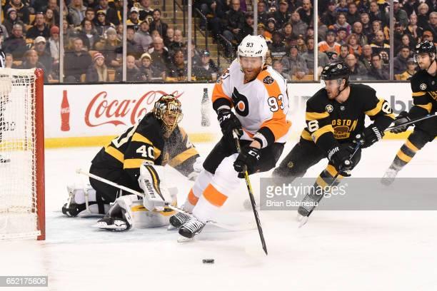 Jakub Voracek of the Philadelphia Flyers fights for the puck against Tuukka Rask of the Boston Bruins at the TD Garden on March 11 2017 in Boston...
