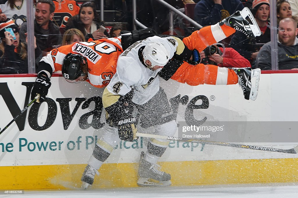 Jakub Voracek #93 of the Philadelphia Flyers gets upended by Rob Scuderi #4 of the Pittsburgh Penguins at the Wells Fargo Center on January 20, 2015 in Philadelphia, Pennsylvania.