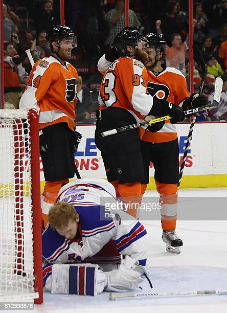 Jakub Voracek of the Philadelphia Flyers is congratulated by teammates Sean Couturier and Michael Del Zotto after Voracek scored the game winning...