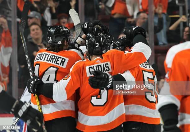 Jakub Voracek of the Philadelphia Flyers is mobbed by teammates Sean Couturier Radko Gudas and Valtteri Filppula after his gamewinning goal in...