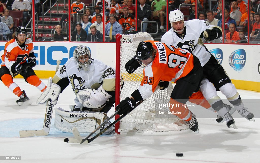 Jakub Voracek #93 of the Philadelphia Flyers is tripped into the net by Rob Scuderi #4 of the Pittsburgh Penguins while playing the loose puck on October 17, 2013 at the Wells Fargo Center in Philadelphia, Pennsylvania. The Penguins went on to defeat the Flyers 4-1.