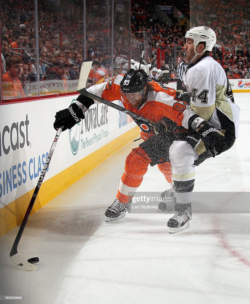 Jakub Voracek #93 of the Philadelphia Flyers keeps control of the puck while being checked by Brooks Orpik #44 of the Pittsburgh Penguins on March 7, 2013 at the Wells Fargo Center in Philadelphia, Pennsylvania.