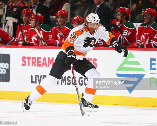 Jakub Voracek of the Philadelphia Flyers plays the puck against the New Jersey Devils during the game at Prudential Center on March 16 2017 in Newark...