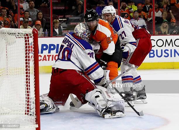 Jakub Voracek of the Philadelphia Flyers scores the game winning goal as Mackenzie Skapski of the New York Rangers defends during a preseason game on...