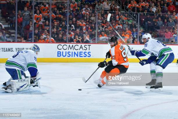 Jakub Voracek of the Philadelphia Flyers shoots and scores on Jacob Markstrom of the Vancouver Canucks as Alexander Edler defends during the second...