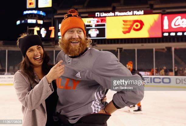 Jakub Voracek of the Philadelphia Flyers skates with Nicole Warnecke during his team's family skate ahead of the 2019 Coors Light NHL Stadium Series...