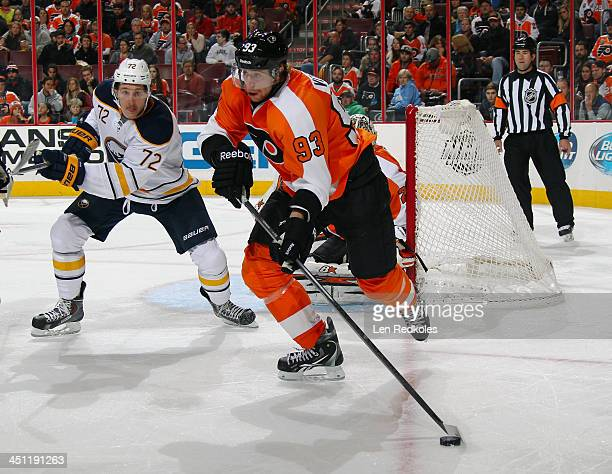 Jakub Voracek of the Philadelphia Flyers skates with the puck out of the corner against Luke Adam of the Buffalo Sabres on November 21 2013 at the...