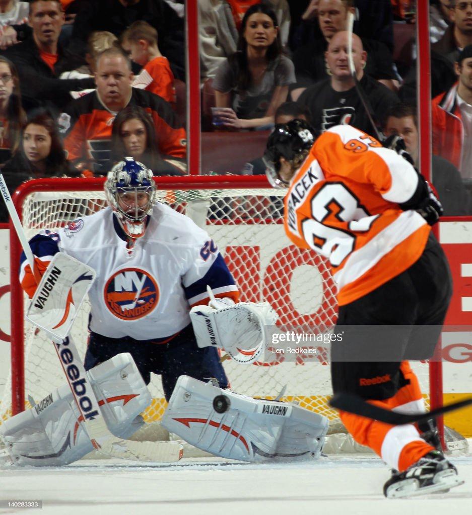 Jakub Voracek #93 of the Philadelphia Flyers takes a shot on goaltender Evgeni Nabokov #20 of the New York Islanders on March 1, 2012 at the Wells Fargo Center in Philadelphia, Pennsylvania.