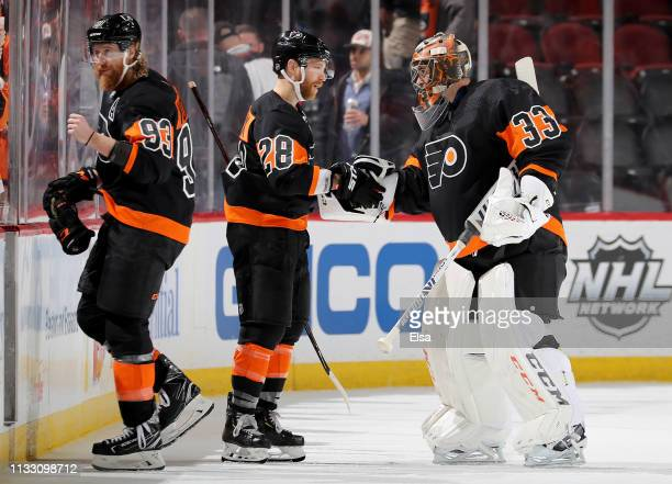 Jakub VoracekClaude Giroux and Cam Talbot of the Philadelphia Flyers celebrates the win over the New Jersey Devils on March 01 2019 at Prudential...