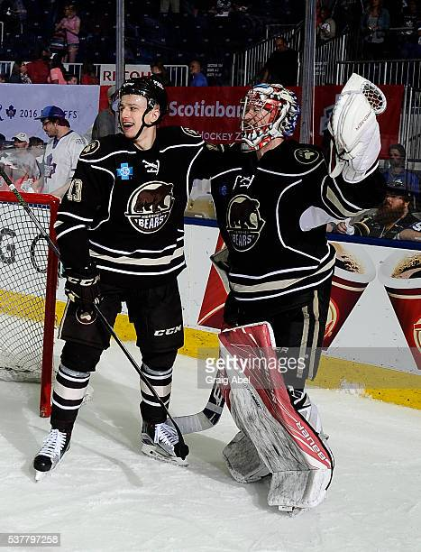 Jakub Vrana and Justin Peters of the Hershey Bears celebrate their series victory over the Toronto Marlies during AHL Eastern Conference Final...
