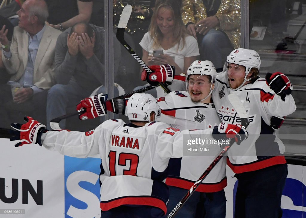 Jakub Vrana #13, Dmitry Orlov #9 and Nicklas Backstrom #19 of the Washington Capitals celebrate after Vrana assisted Backstrom on a first-period goal against the Vegas Golden Knights in Game One of the 2018 NHL Stanley Cup Final at T-Mobile Arena on May 28, 2018 in Las Vegas, Nevada. The Golden Knights defeated the Capitals 6-4.