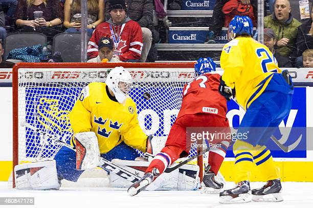 Jakub Vrana of Czech Republic fires the puck past Linus Soderstrom of Sweden during the 2015 IIHF World Junior Championship on December 26 2014 at...