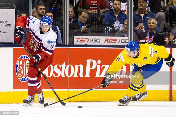 Jakub Vrana of Czech Republic moves the puck against Robin Norell of Sweden during the 2015 IIHF World Junior Championship on December 26 2014 at the...