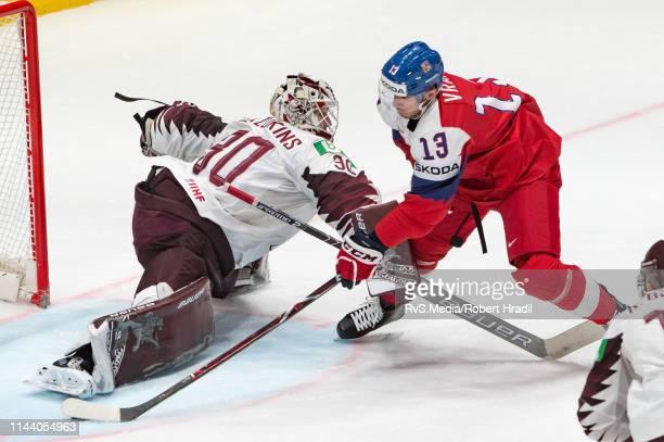 Jakub Vrana of Czech Republic scores a goal against Goalie Elvis Merzlikins of Latvia during the 2019 IIHF Ice Hockey World Championship Slovakia...