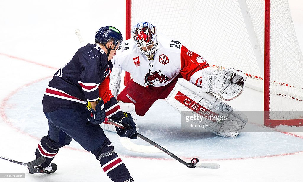 Jakub Vrana #13 of Linkoping takes a shot on goal against Jaroslav Hubl #24 of HC Bolzano during the Champions Hockey League group stage game between Linkoping HC and HC Bolzano on August 24, 2014 in Linkoping, Sweden.