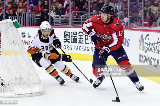 Jakub Vrana of the Washington Capitals brings the puck around the net against Brandon Montour of the Anaheim Ducks in the first period at Capital One...