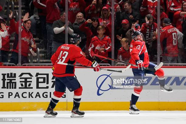 Jakub Vrana of the Washington Capitals celebrates after scoring his third goal of the game for a hat trick in the second period against the Calgary...