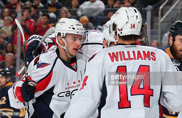 Jakub Vrana of the Washington Capitals celebrates his first career NHL goal against the Buffalo Sabres with teammate Justin Williams at the KeyBank...