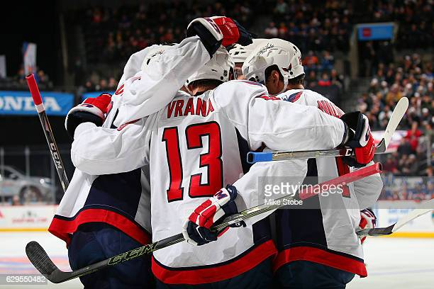 Jakub Vrana of the Washington Capitals celebrates his second period goal against the New York Islanders with teammates at the Barclays Center on...