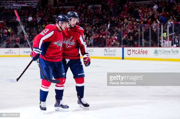 Jakub Vrana of the Washington Capitals celebrates with Evgeny Kuznetsov after scoring a first period goal against the Colorado Avalanche at Capital...