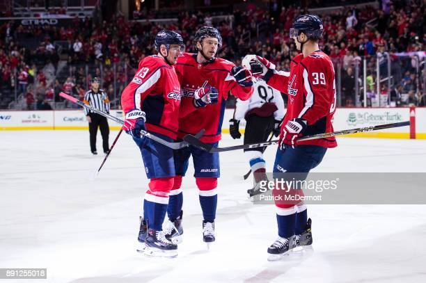 Jakub Vrana of the Washington Capitals celebrates with Evgeny Kuznetsov and Alex Chiasson after scoring a first period goal against the Colorado...