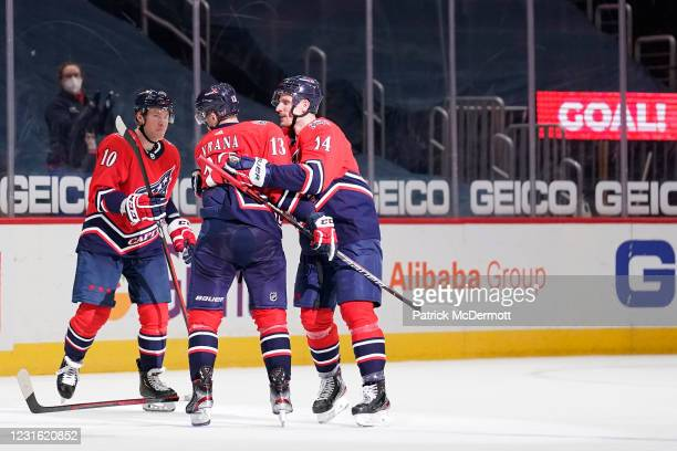 Jakub Vrana of the Washington Capitals celebrates with teammates Daniel Sprong and Richard Panik after scoring the game winning goal against the New...