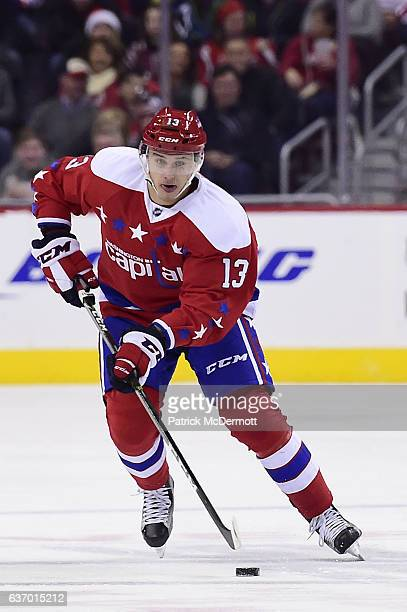 Jakub Vrana of the Washington Capitals controls the puck against Tampa Bay Lightning in the third period during a NHL game at Verizon Center on...