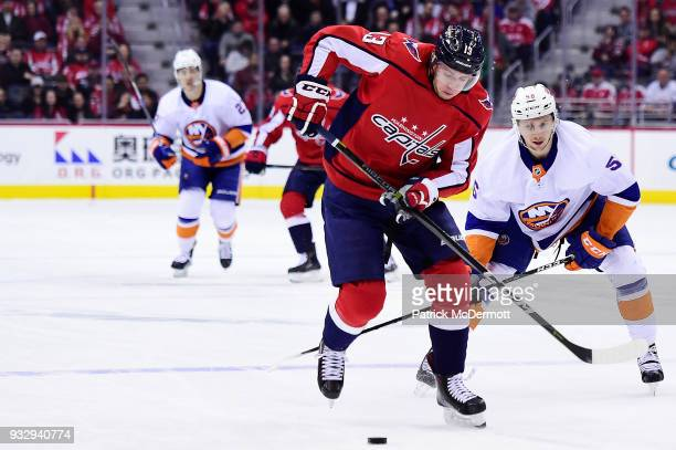 Jakub Vrana of the Washington Capitals controls the puck against Tanner Fritz of the New York Islanders in the first period at Capital One Arena on...