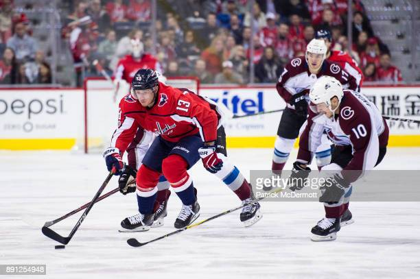 Jakub Vrana of the Washington Capitals controls the puck against Sven Andrighetto of the Colorado Avalanche in the third period at Capital One Arena...