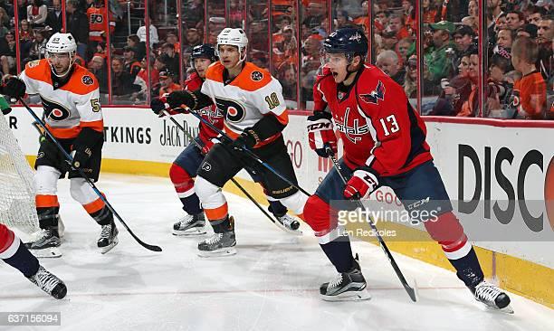 Jakub Vrana of the Washington Capitals in action against Brayden Schenn and Shayne Gostisbehere of the Philadelphia Flyers on December 21 2016 at the...