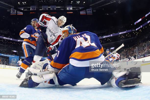 Jakub Vrana of the Washington Capitals is stopped during the second period by Jaroslav Halak of the New York Islanders at the Barclays Center on...