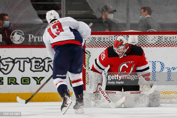 Jakub Vrana of the Washington Capitals scores a goal past Mackenzie Blackwood of the New Jersey Devils during the third period at Prudential Center...