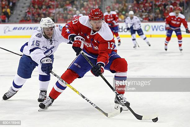 Jakub Vrana of the Washington Capitals skates past Michael Bournival of the Tampa Bay Lightning during the second period at Verizon Center on...