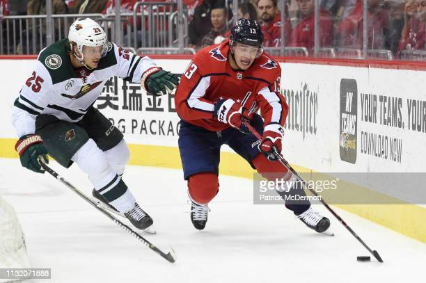 Jakub Vrana of the Washington Capitals skates with the puck against Jonas Brodin of the Minnesota Wild in the third period at Capital One Arena on...